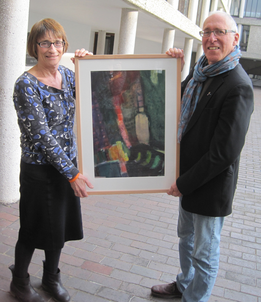 Jan Scriven receiving gift of painting from JR